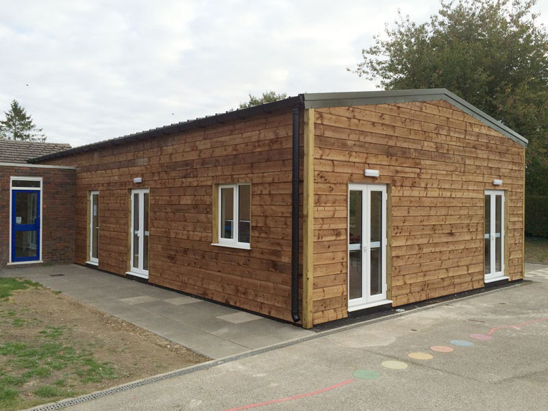 Wood clad extension building with windows & doors