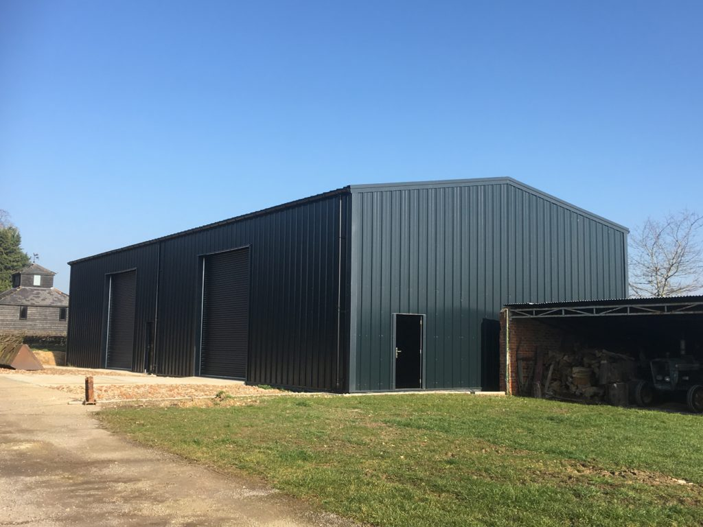 Large Anthracite coloured Industrial building with beautiful blue sky line